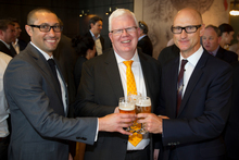 Moa's marketing manager Sunil Unka (left) and chief executive Geoff Ross (right) enjoy a beer with NZX boss Tim Bennett after the company listed on the NZX in November. Photo / Greg Bowker