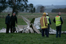 Investigators look over the wreckage of a Cessna 152 in which Jessica Neeson and Patricia Smallman died after a mid-air collision in July 2010. Photo / Kevin Bills