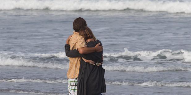 Meg Strange, wife of Adam Strange, is comforted by friend Simon Shephard. Photo / Brett Phibbs