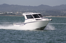 Okelani is a custom-built Bluewater 7.7 Weekender, which features twin king/queen seats, a lockable cabin and a handy cooker in the hardtop. Photo / Supplied