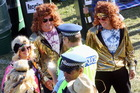 Even the patrolling police were impressed by these disco lads and their equally glittering companions. Photo / Paul Taylor