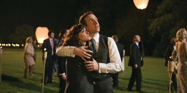 Nat (Rose Byrne, left) and Josh (Rafe Spall) at their wedding, in a scene form I Give It A Year. Photo / Supplied