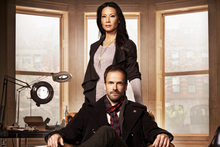 Jonny Lee Miller is a tattooed Holmes, with a female Watson (Lucy Liu).  Photo / Supplied 