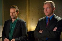 Jonny Lee Miller (left) as Sherlock Holmes and Aidan Quinn as Captain Toby Gregson. Photo / AP