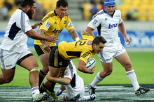 Tim Bateman of the Hurricanes is tackled during his side's defeat to the Blues. Photo / Getty Images