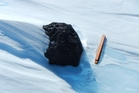 An 18kg meteorite found by the Belgo-Japanese SAMBA meteorite team during a field trip on the Nansen Ice Field Photo / International Polar Foundation/Vinciane Debaille