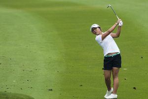 Lydia Ko eyes the green at the Thailand Open. Photo / Getty Images