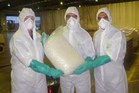 Australian Federal Police officers with some of their largest ever seizure of methamphetamine. Photo / AFP