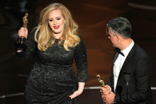 Adele with her Oscar for best original song. Photo/AP