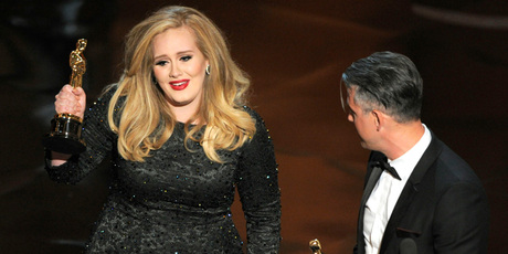 Adele accepts her Oscar for Best Original Song. Photo/AP