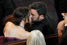 Ben Affleck kisses his wife Jennifer Garner after winning the Oscar for best picture. Photo/AP