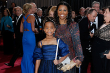 Quvenzhane Wallis, left, and mother Qulyndreia Wallis arrive at the Oscars. Photo/AP