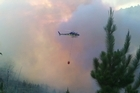 Firefighters battle a large forest fire north of Auckland. Video supplied by Daniel Fenning
