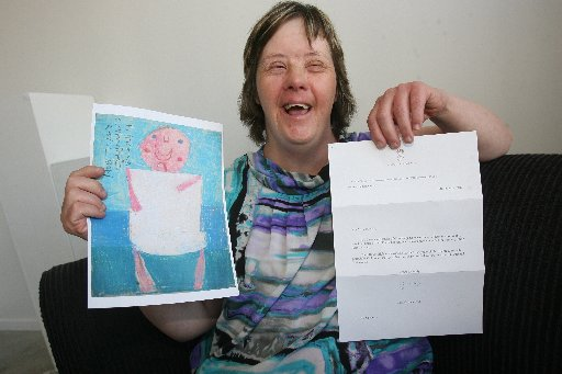 UNBELIEVABLE: Catherine Scully holds a copy of her portrait of the royal baby and a letter from St James Palace at King Street Artworks, Masterton.