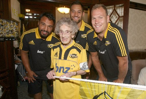 SCRUM: Hurricanes players Ash Dixon (left), Jack Lam and James Broadhurst pack down with Masterton centenarian and lifelong rugby fan Alma Hamilton, who dressed in Hurricanes colours for the occasion.
