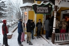 Smokers queue outside the Cannabis Club in downtown Breckenridge waiting for the 8am opening. Photo / AP