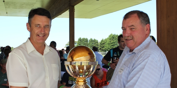 PROUD MOMENT: Mayor Stuart Crosby (left) and Bay of Plenty Cricket Trust Chairman Chris Rapson, with the ICC Cricket World Cup Qualifier 2014 trophy.PHOTO/PETER WHITE