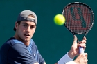 John Isner hurt his ankle but organisers say he will play in Auckland. Photo / NZPA