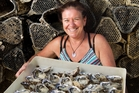 Anne Louden's enjoyment comes from introducing people to Coromandel's oysters and mussels. Photo / Alan Gibson