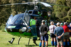 Emergency staff attend the sick woman in the Urewera ranges. PHOTO/Greenlea Rescue Helicopter
