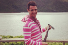 All Black Dan Carter looking good in a pink onesie while on holiday in the Marlborough Sounds.