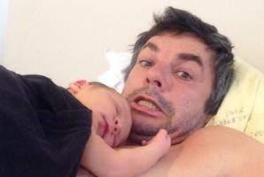 Marcus Lush hams it up in a selfie with newborn son Tracker. Photo / Twitter
