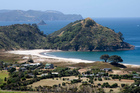 These houses on Great Barrier Island have been built with a generous setback from the coastal margin, retaining much of the natural character of the beach.