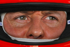 Michael Schumacher is pictured in the pits during the Formula One Bahrain International Circuit. Photo / AP