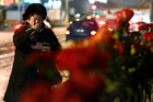 A woman cries after laying flowers outside the Volgograd main railway station that was attacked by a suicide bomber Sunday, killing 17 people, including the attacker, in Volgograd, Russia. Photo / AP