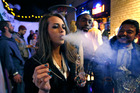 Partygoers smoke marijuana during a Prohibition-era themed New Year's Eve party celebrating the start of retail pot sales. Photo / AP