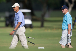President Barack Obama walks with Prime Minister John Key to the second green as they golf at Kaneohe Klipper Golf Course. Photo / AP