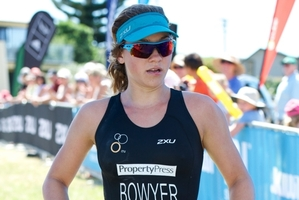 Aucklander Natasha Bowyer wins her first triathlon in Whangamata yesterday. Photo / Darryl Carey