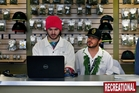 Employees Chris Broussard and David Marlow work inside Medicine Man marijuana store. Photo / AP