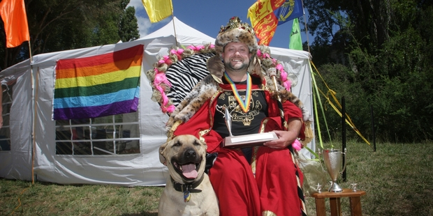 Queen Andrew Morgan holds court outside the royal tent with Shadow, the dog, at his side. Photo/Bevan Conley