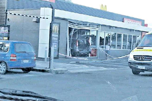 DRIVE-THRU: A person required medical treatment after a car smashed through the side of Dannevirke's McDonald's Restaurant last night.