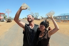 Ben Harris and Kellie Glab keep cool in Oodnadatta, South Australia, during extreme heat conditions. Photo / The Australian