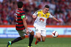 Michael Beauchamp of the Wanderers tackles Louis Fenton of the Phoenix during the round 13 A-League match against the Western Sydney Wanderers. Photo / Getty Images