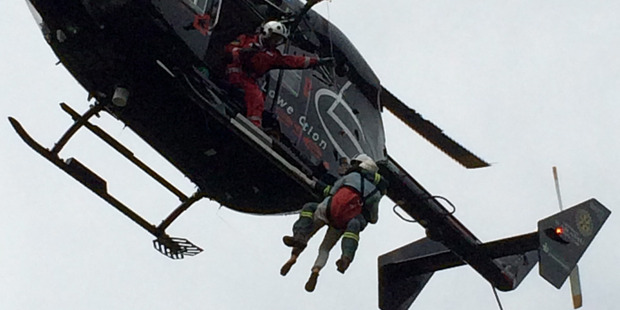 The trapped victims had to be winched to safety. Photo / Greenlea rescue helicopter