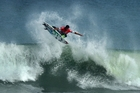 New Zealand surfer Richard Christie blasts off the top of a wave at Waikanae Beach in Gisborne during the O'Neill Coldwater Classic surf contest.