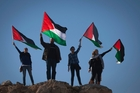 Demonstrators wave Palestinian flags during a protest against the expansion of the Maaleh Adumim settlement. Photo / AP