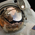 A close-up of Astronaut John Grunsfeld shows the reflection of Astronaut Andrew Feustel, perched on the robotic arm and taking the photo. Photo / NASA