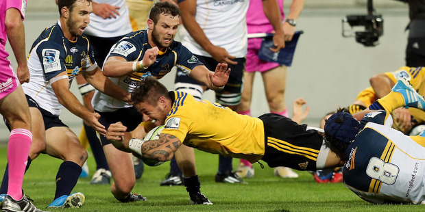 TJ Perenara scores for the Hurricanes against the Brumbies. Photo / Getty Images
