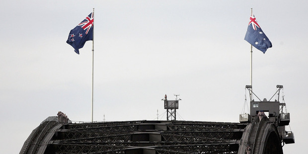 Partnership: The New Zealand flag, left, alongside Australia's on Anzac day. Australia and New Zealand may have to work together to make the most of what we both have. Photo / Getty Images