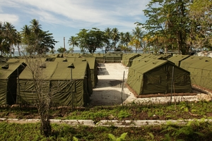 PNG police are said to have allowed locals to break into the Manus camp and beat detainees. Picture / Getty Images