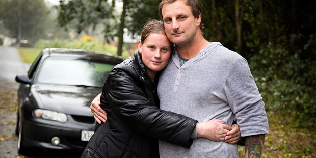 Bruce McDonald with his daughter Michaela, 17, after they were trapped in their car, surrounded by live power wires bought down during a wild storm to hit Canterbury. Photo / Martin Hunter