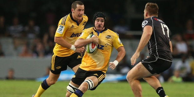 Hurricanes loosie Adam Hill, center, enjoys the rough and tumble. Photo / Getty Images
