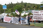 The hikoi outside Paihia's Scenic Circle Hotel where yesterday's Tuhoronuku information meeting was cancelled after the protest group arrived. Photo/Peter de Graaf