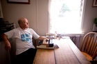 On his days off Bob Orr taps out his poetry on a typewriter at the kitchen table of his small flat. Photo / Dean Purcell