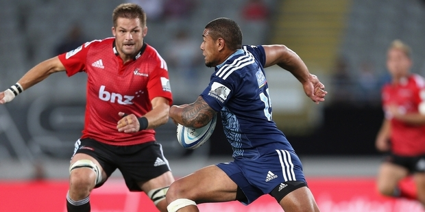 Richie McCaw, left, is out injured but Charles Piutau (47 points at $8,070,000) has performed well. Photo / Getty Images