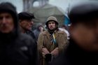 Ukrainians are lining up to join what they fear will be a battle against Russia. Picture / AP